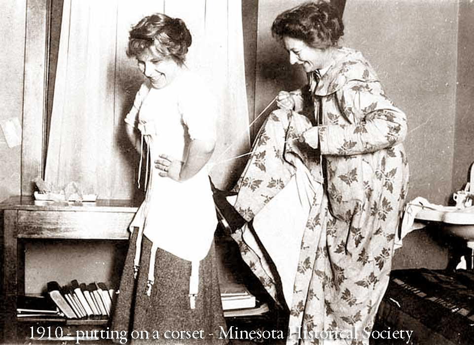 1910 putting on a corset
